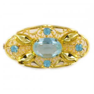 Oval perforated brooch with aquamarine stones, gilded 54x28 mm