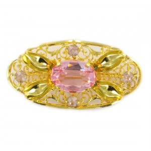 Oval perforated brooch with rose stones, gilded 54x28 mm