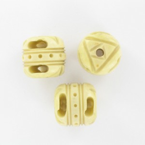 Barrel shaped bead with embossed patterns, beige 17x18 mm