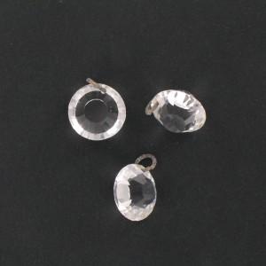 Pierre taillée à l'identique des 2 côtés, 1 trou décentré, cristal 13 mm