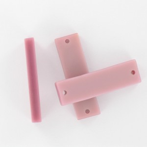 Rectangular plaque with 2 holes, pink 35x10 mm