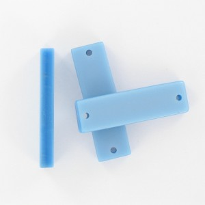 Rectangular plaque with 2 holes, light blue 35x10 mm