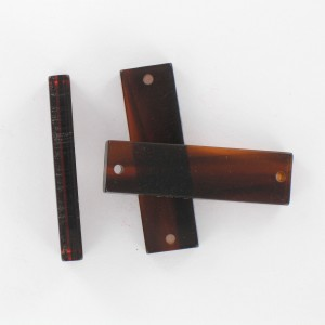 Rectangular plaque with 2 holes, tortoise shell 35x10 mm